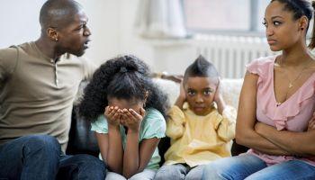 parents qurraling in front of children