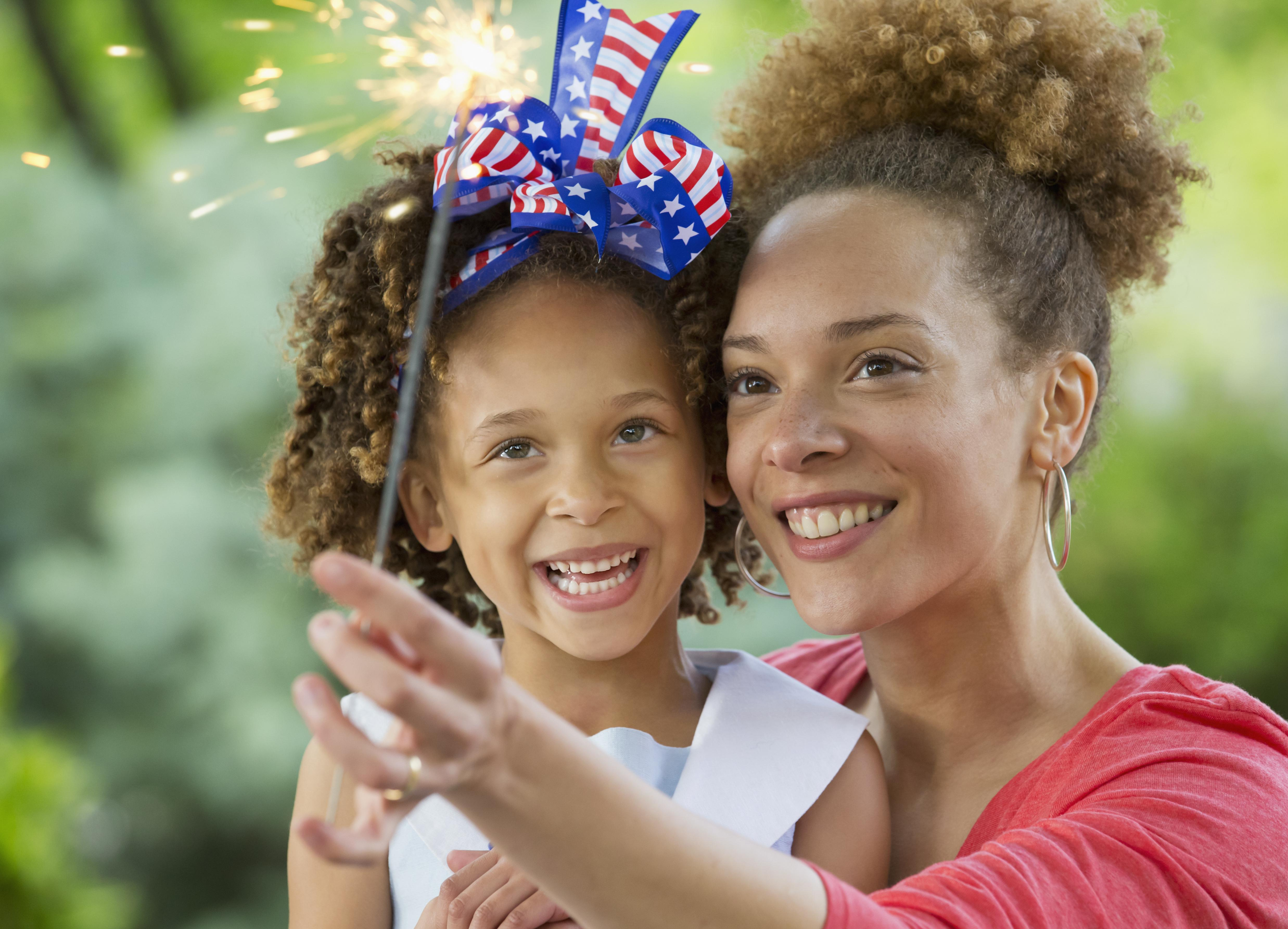 Black mother and daughter celebrating 4th of July