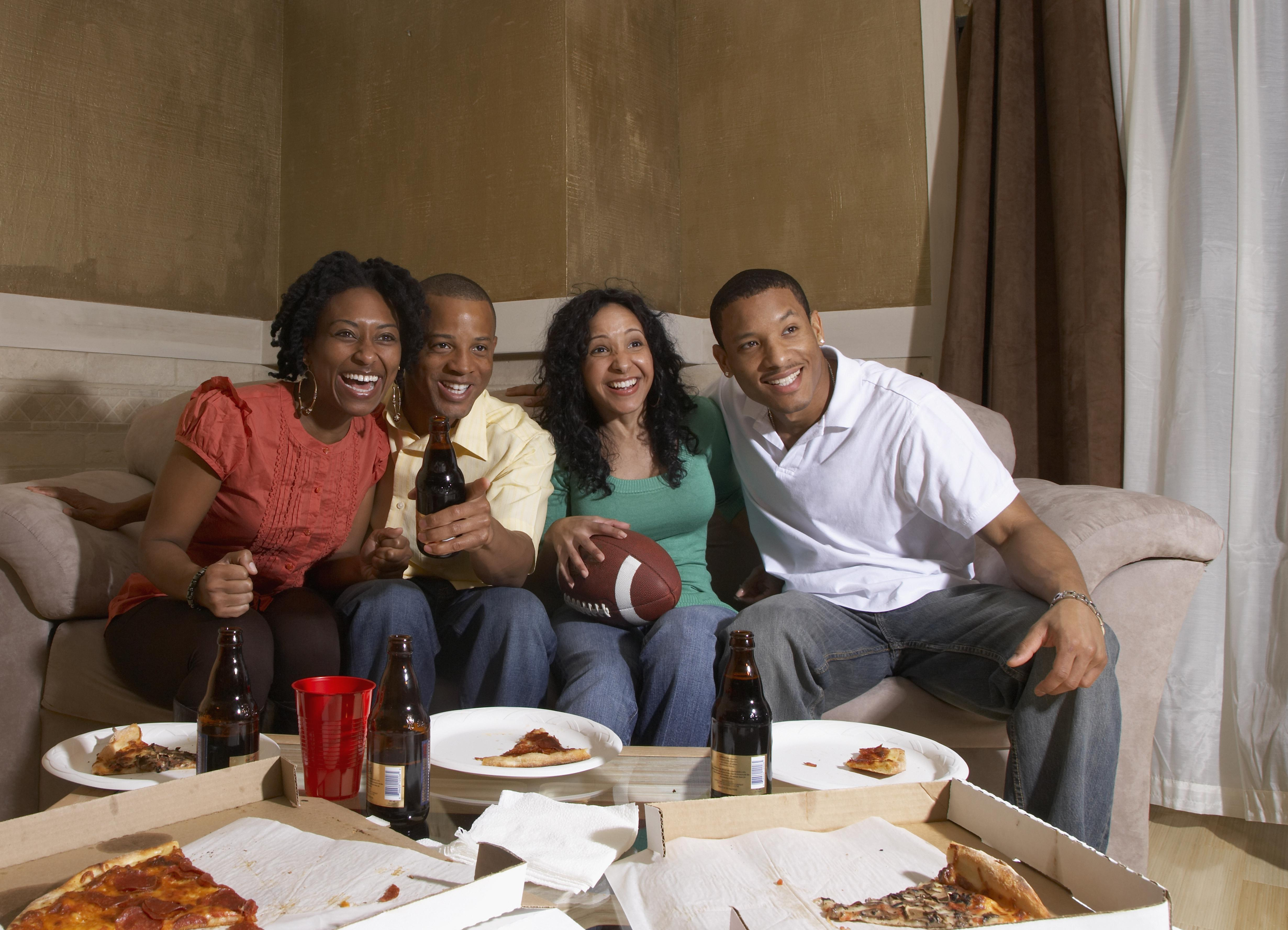 Multi-ethnic friends watching sports on television