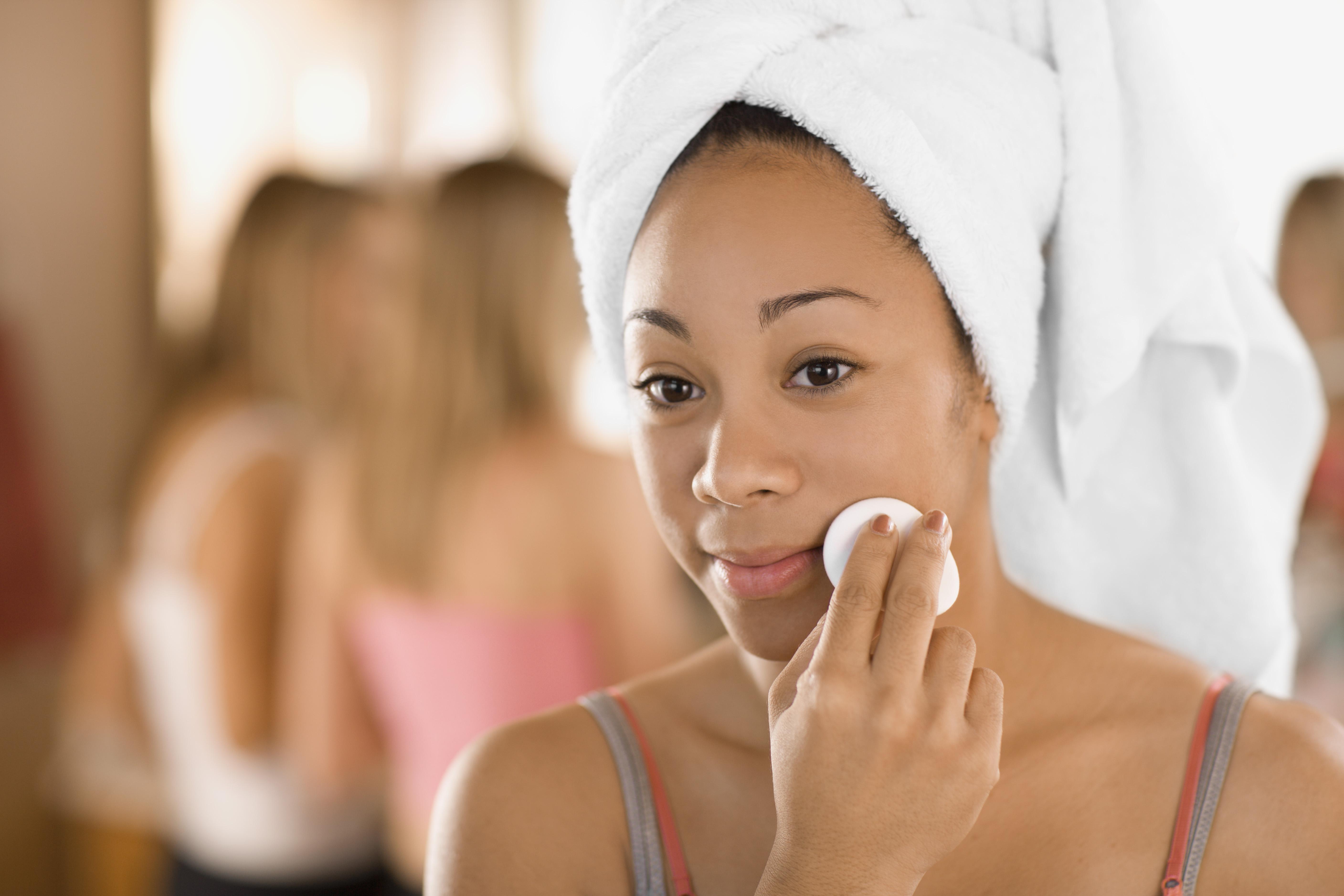 Teenage girl removing makeup