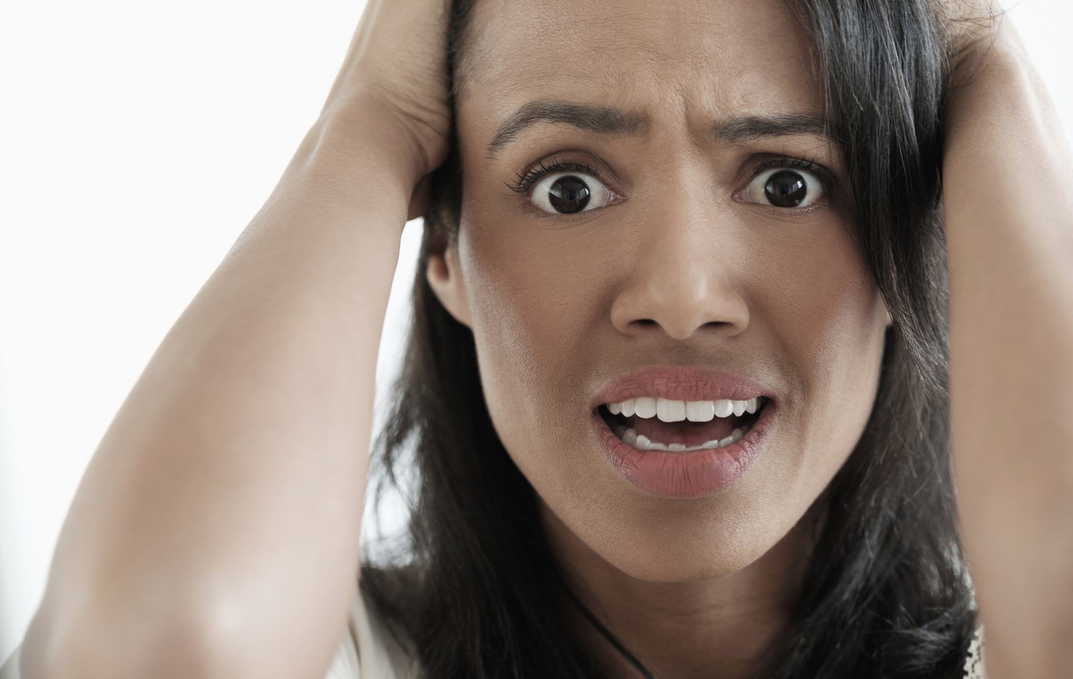 Close up of mixed race woman gasping