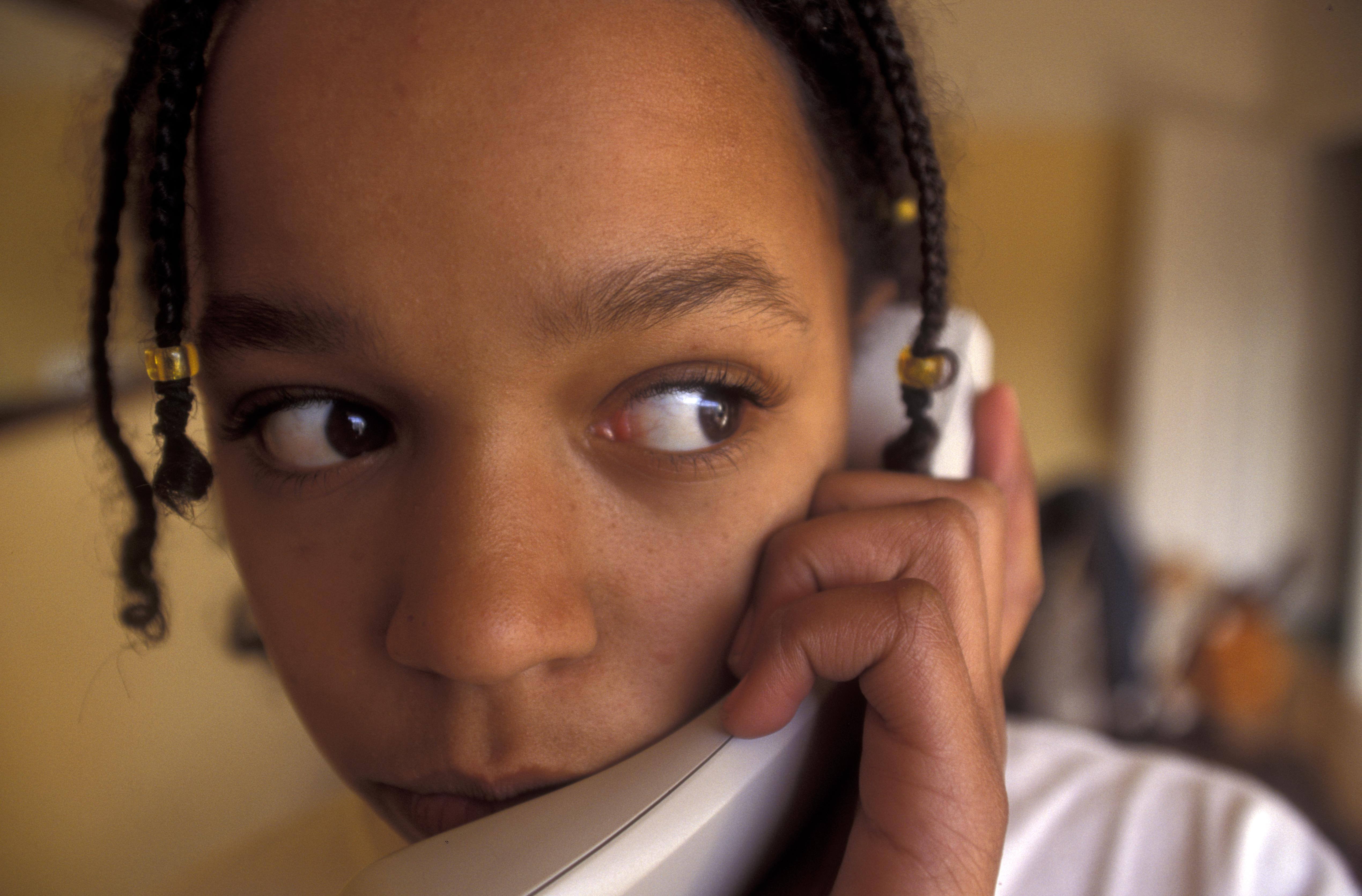 Teenager talking on the telephone
