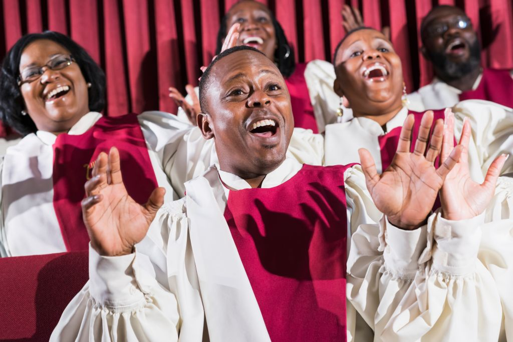 Mature black man with group, singing in church choir