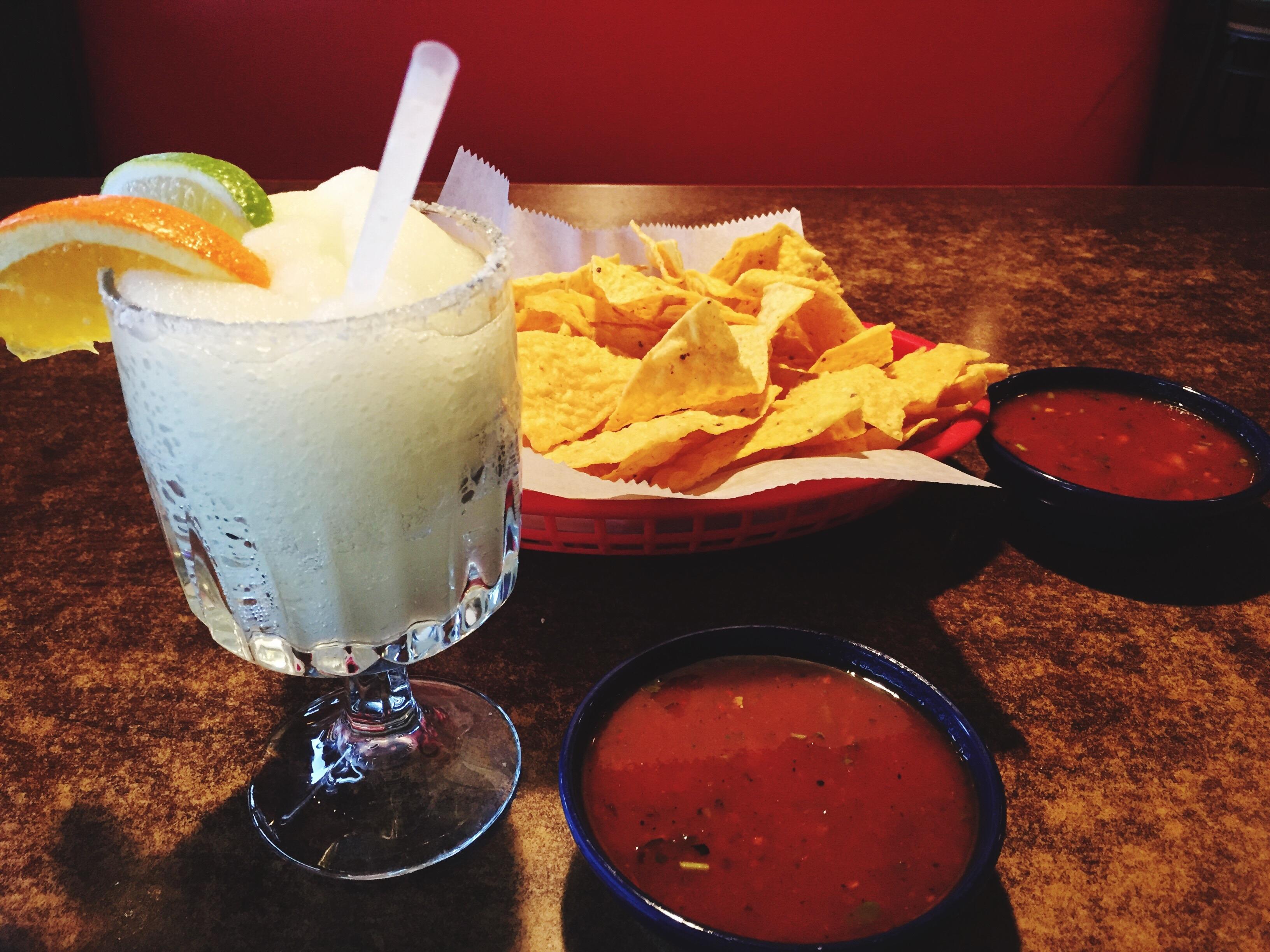 Close-Up Of Margarita And Food On Table