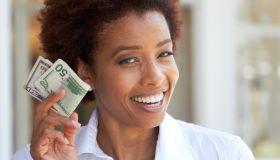African American woman holding 50 dollar bill