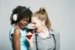 Two young women singing