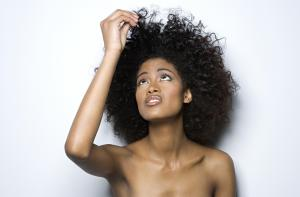 Young woman holding up her hair, close-up