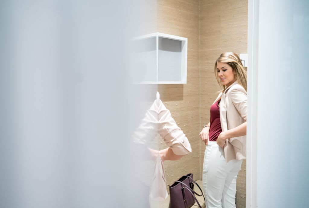 Shopping woman trying clothes in the fitting room