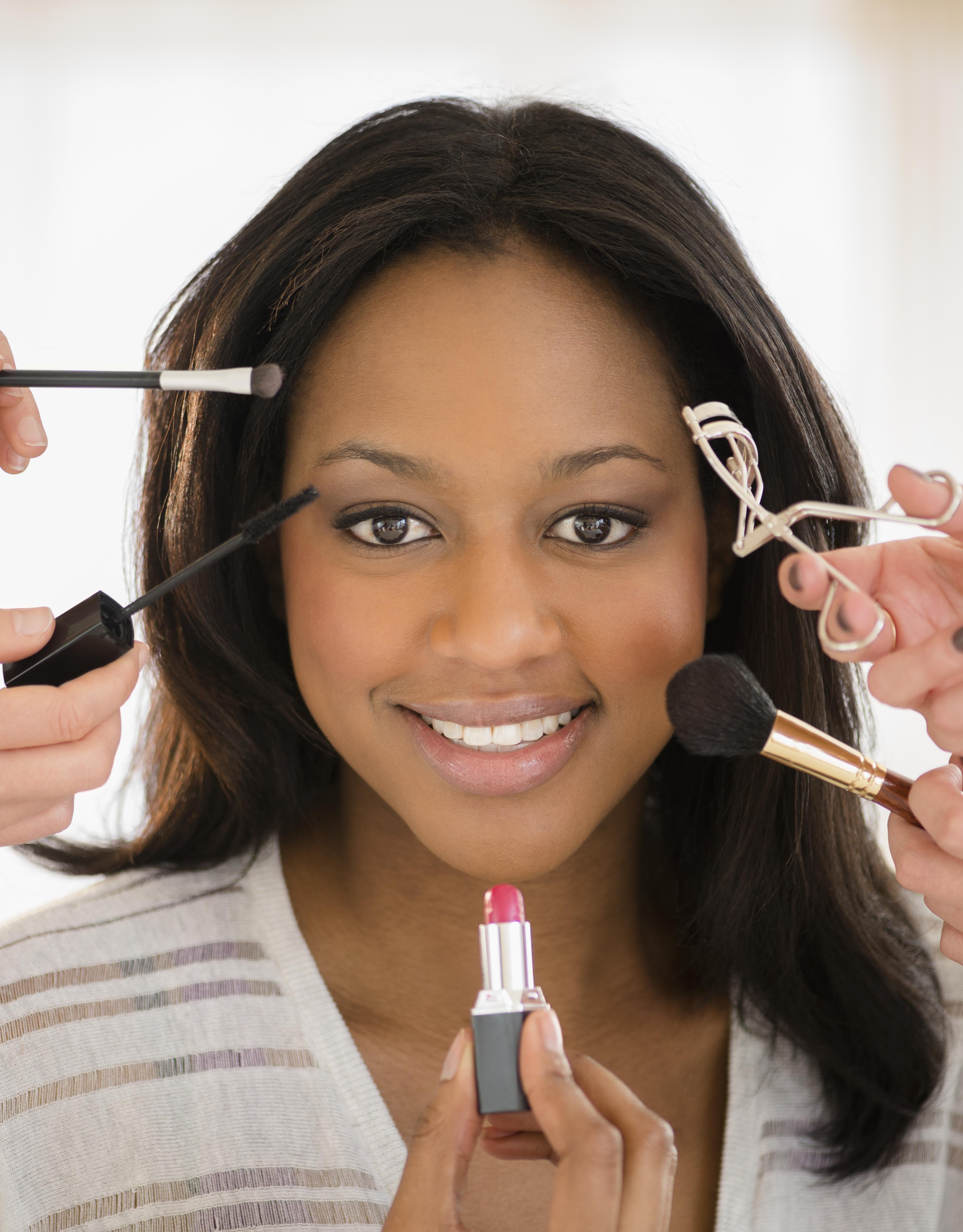 African American woman having makeup applied