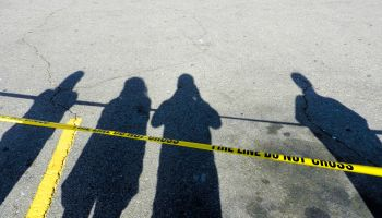Cordon Tape Over Road With Shadow Of People