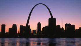 City skyline with arch at sunset, St. Louis, Missouri, USA