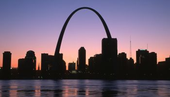 City skyline with arch at sunset, St. Louis, Missouri, USA