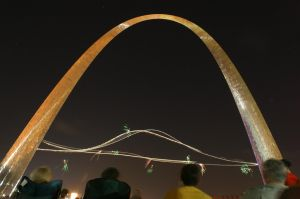 People watch an airshow at the Arch in S