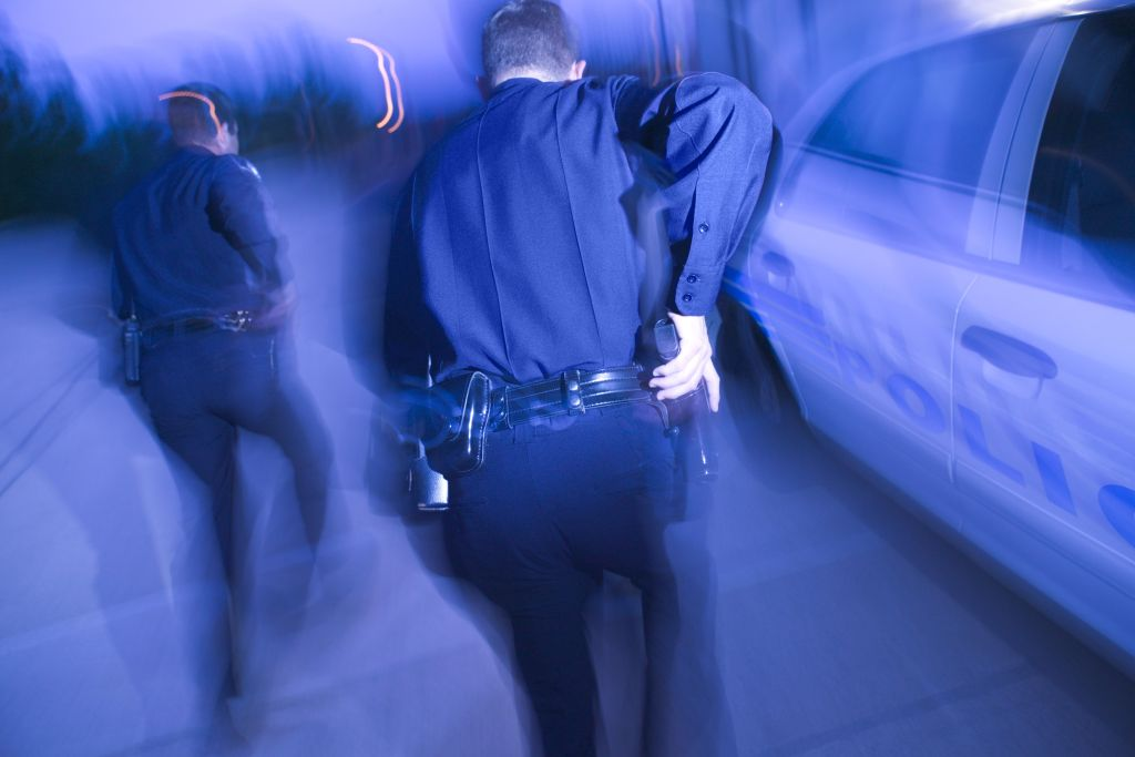 Police officers running