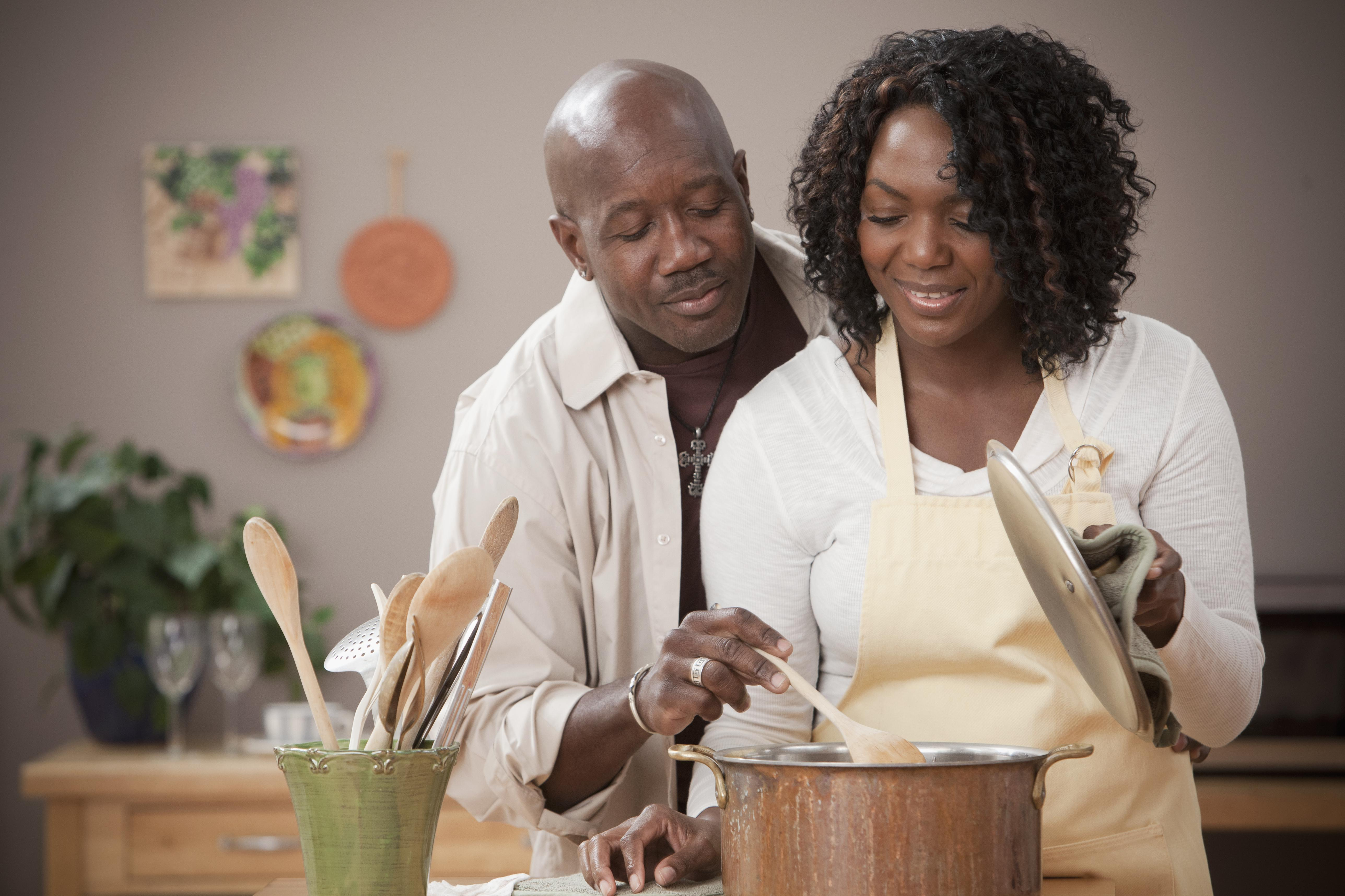 African American couple cooking together