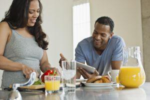 Couple making breakfast in loft apartment