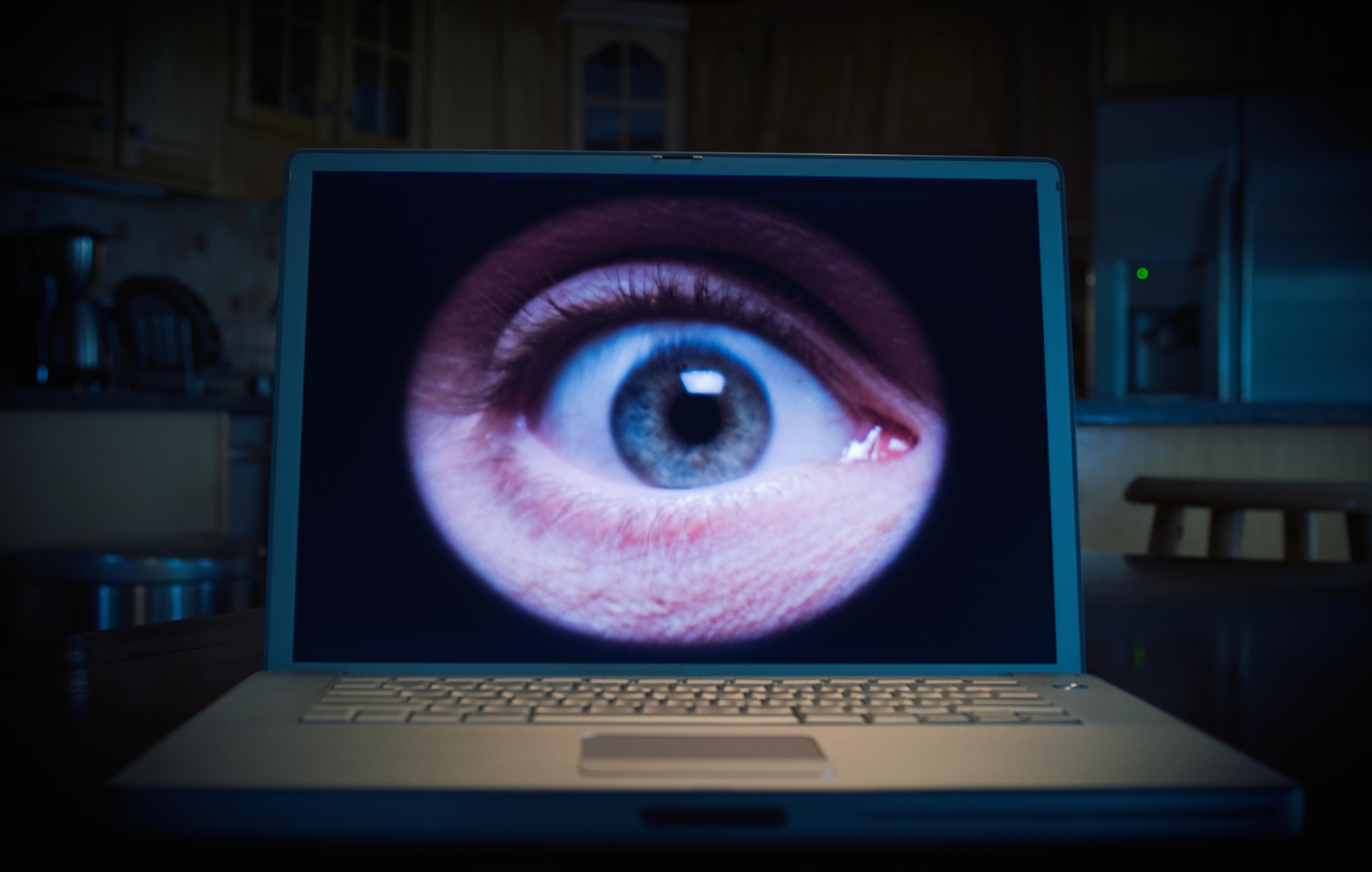 Man's eye on lap top computer