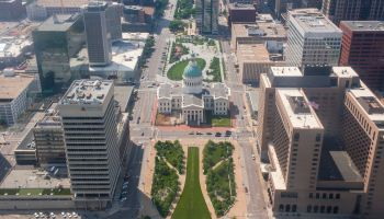 Park in front of state capitol and surrounding buildings, St Louis, Missouri, United States