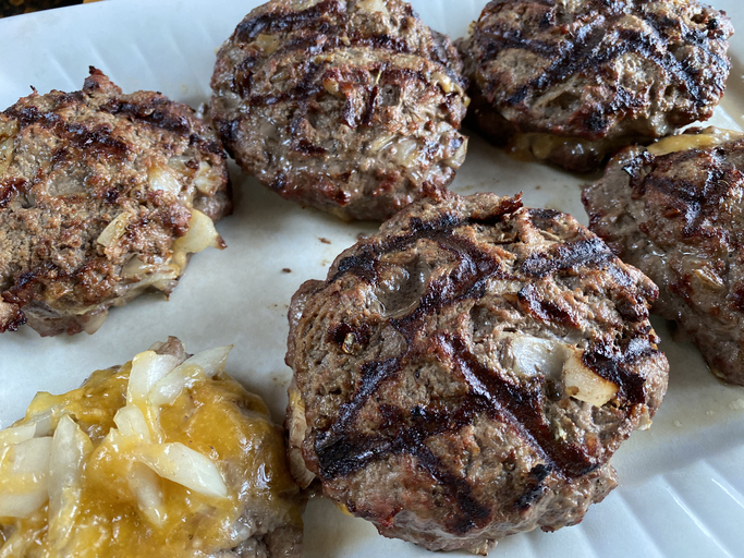 Grilled hamburgers on a plate.